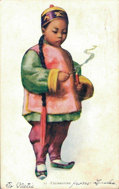 China Chinese Boy Celebrating Fireworks 1900s Postcard 03.75