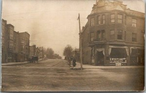1910s RPPC Photo Postcard Street Scene / Erskine Real Estate C.W. Gilbert Store