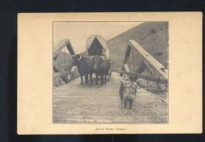 BURNT RIVER OREGON OXEN DRAWN COVERED WAGON BRIDGE VINTAGE POSTCARD