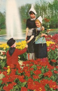 Mother with sons, picking flowers t Garden  Nice Dutch Postcard 1950s