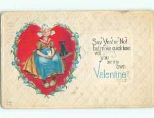 Pre-Linen valentine BLACK CAT SITS BESIDE HOMELY LOOKING WOMAN ON BENCH k5612
