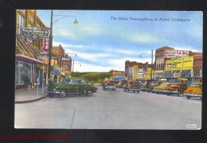 ATOKA OKLAHOMA DOWNTOWN MAIN STREET SCENE VINTAGE CARS STORES POSTCARD