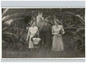 3 Women Holding Purses Outdoor Scene with Large Plants 1948 RPPC European