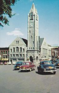 The Clock on the massive tower of the Baptist Church in Watertown,  New York,...