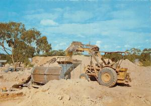 Australia New South Wales Lightning Ridge Dirt being fed into rumbler