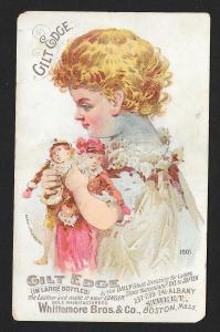 VICTORIAN TRADE CARD Gilt Edge Shoe Dressing Girl Holding Dolls