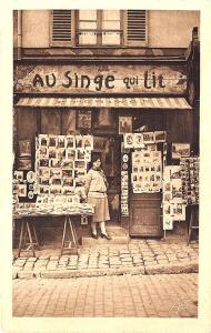 Paris France Au Singe Qui LIt Gremillet Selling Etchings Postcard Rack