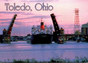 Ohio Toledo Ship Passing Under Drawbridge At Twilight