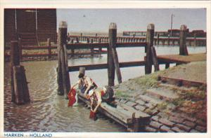 Netherlands Marken Girls Washing Clothes in River