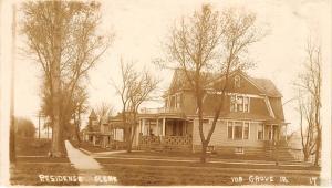 Ida Grove IA Home w/Gambrel Roof on Dirt Intersection~Church~Sidewalk RPPC c1910