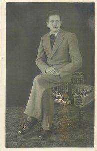 Postcard Social history XX Century portrait man on a chair suit tie