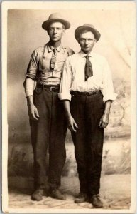 Vintage RPPC Studio Real Photo Postcard Two Men in Hats Clarence Wasson c1910s