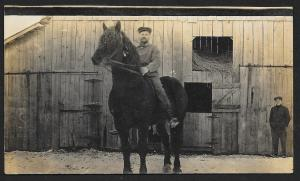 Man on Horse in Front of Barn RPPC Unused c1910s