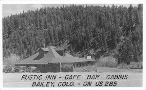 H25/ Bailey Colorado RPPC Postcard 1949 Rustic Inn Café Bar Cabins