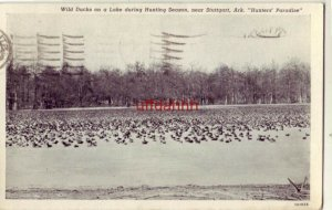 WILD DUCKS ON A LAKE, HUNTING SEASON NEAR STUTTGART, AR 1941 HUNTERS' PARADISE