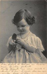 Little Girl Holding a Flower Postcard