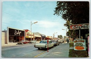 Oscoda MI~Main Street~Chamber Tourist Info~Bop & Stop Convenience Store~1960s