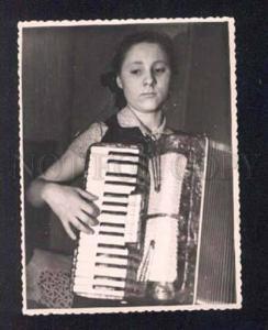 042423 Russian girl Musician w/ native BAYAN photo