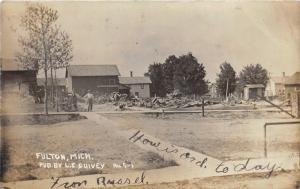 Fulton Michigan~Men Posing by Equipment~Houses~Debris in Yard~Street~1909 RPPC