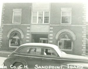 Vtg Postcard RPPC Sandpoint Idaho ID Bonner County Courthouse Street View Car