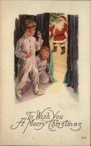 Christmas - Kids Peek Around Corner at Santa Claus #510 c1920 Postcard