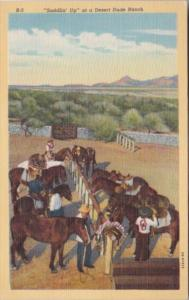 Saddlin'Up Horses At A Desert Ranch Curteich