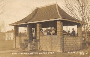 Clare MI~SHARP CLOSEUP!~Family of 6 Enjoys Bandstand~Water Works Park~RPPC 1911