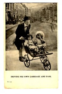 Man Pushing Little Girls in Vintage Stroller, Driving His Own Pair, Humour