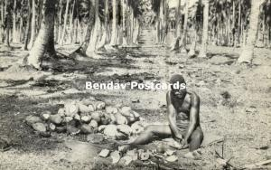 new hebrides, Vanuatu, Native Man extracting Coconut Kernal for Copra (1950s)