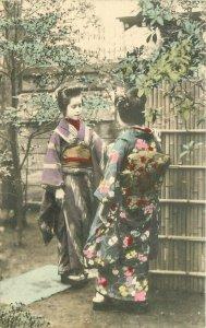 C-1910 Garden Conversation Ethnic Dress Woman Japan Postcard 7802