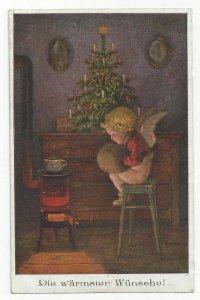 CHRISTMAS, PU-1921; Cherub keeping warm on a stool, hand muff, decorated tree