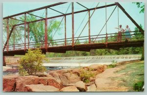Keshena Wisconsin~Bridge Crossing Wolf River~Boulders~People on Bridge~1950s