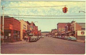 Iron River MI Main Street Storefronts Rexall Drug Store Old Cars Postcard