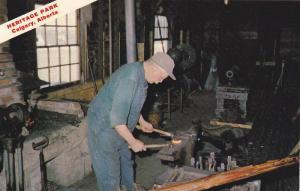 Blacksmith working on anvil , Heritage Park , Calgary , Alberta , Canada , 50...