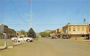 Thermopolis Wyoming~Main Street~Golden Rule~Drug Store~Jewelry~Schlitz~1950s Car