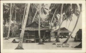 Native Huts New Guinea Real Photo Postcard