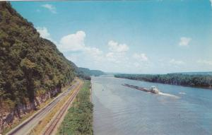 Vista of Mississippi River showing three forms of transportation, train track...