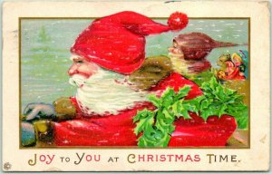 1923 CHRISTMAS Postcard SANTA CLAUS in Red Cap & Little Elf in Sleigh JOY TO YOU