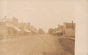Thor Iowa~Main Street~Western Buildings~Wooden Sidewalk~Dirt Road~1908 RPPC
