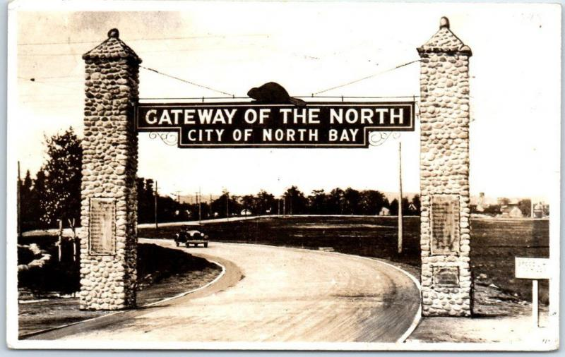NORTH BAY Ont. Canada RPPC Photo Postcard GATEWAY OF THE NORTH Road Sign 1945