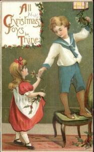 Christmas - Children Decorate Holly & Mistletoe c1910 Postcard