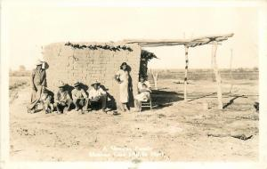 A Mexican Family In Front Of Adobe Hut real Photo Postcard