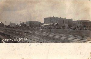 F80/ Raymond Minnesota RPPC Postcard c1910 Railroad Stores Church