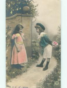 tinted rppc c1910 BOY GIVES FLOWERS TO GIRL AC9172