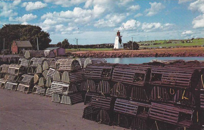 LIGHTHOUSE, Lobster Traps On The Wharf, Lighthouse In The Background at Victo...