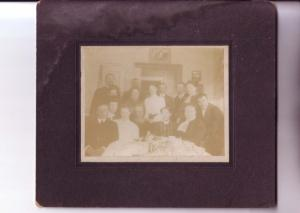 Mounted Photograph of Mounted Large Family Around Table