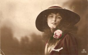 Pretty similing lady. Fantasy hat. Pink rose·  Nice old vintage Postcard