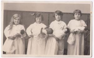 Social History, Group of Children With Baby Dolls in Swaddling RP PPC, c 1910's