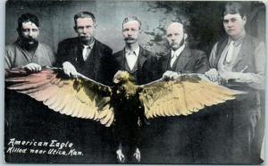Vintage Kansas Postcard 5 Men w/ AMERICAN EAGLE KILLED NEAR UTICA, KAN. c1910s