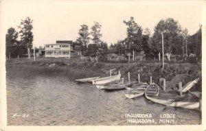 Inguadona Minnesota boats at shore Inguadona Lodge real photo pc ZE686150